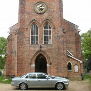 Wedding car with Ivory Riboons at Copythorne Church